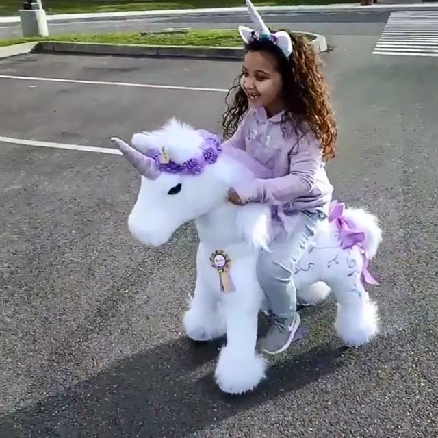 Enjoy the Freedom on her unicorn