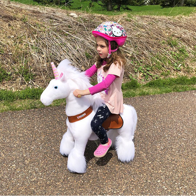 riding a unicorn in the countryside